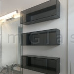 Grey Glass Cabinets with Grey Mirror Back